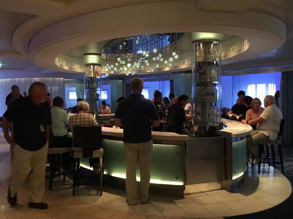 People at a bar on the Celebrity Equinox
