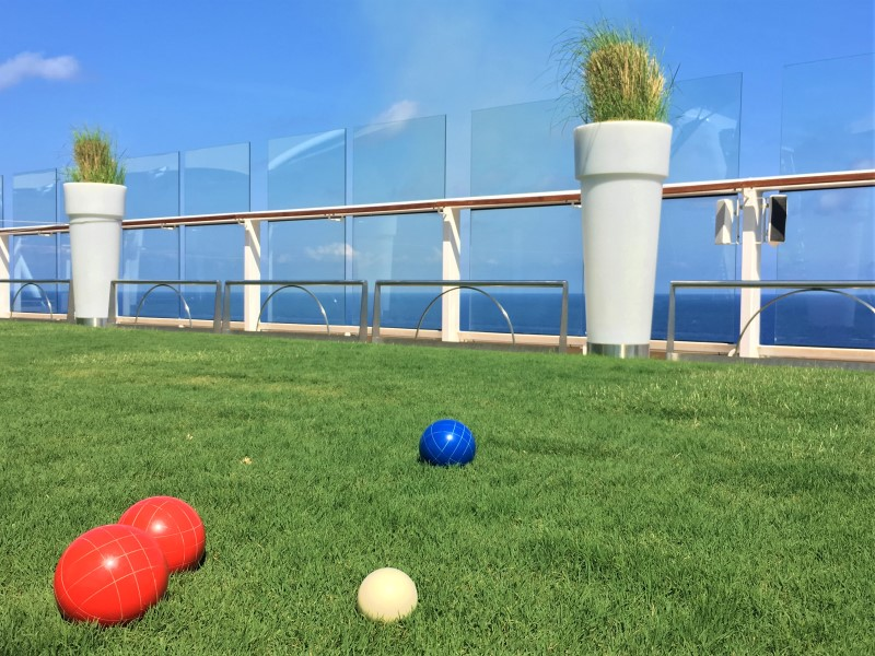 The Grassy Lawn on Celebrity Equinox, Deck 15 with bocce balls in the foreground
