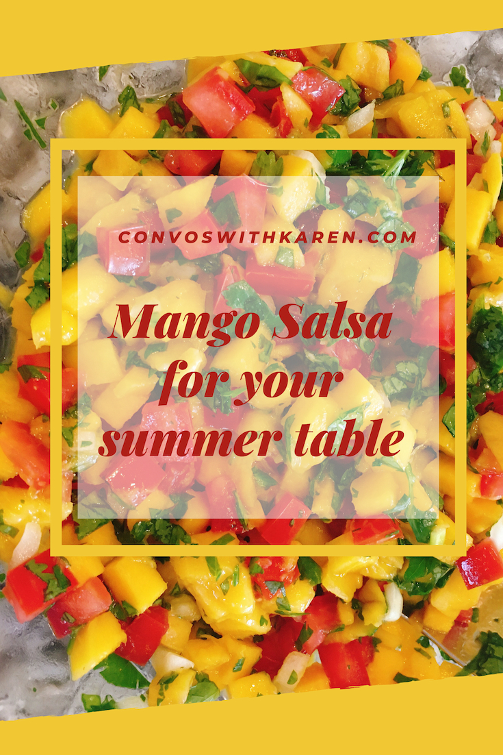 Mango salsa is made with fresh mango, tomatoes, lime and cilantro