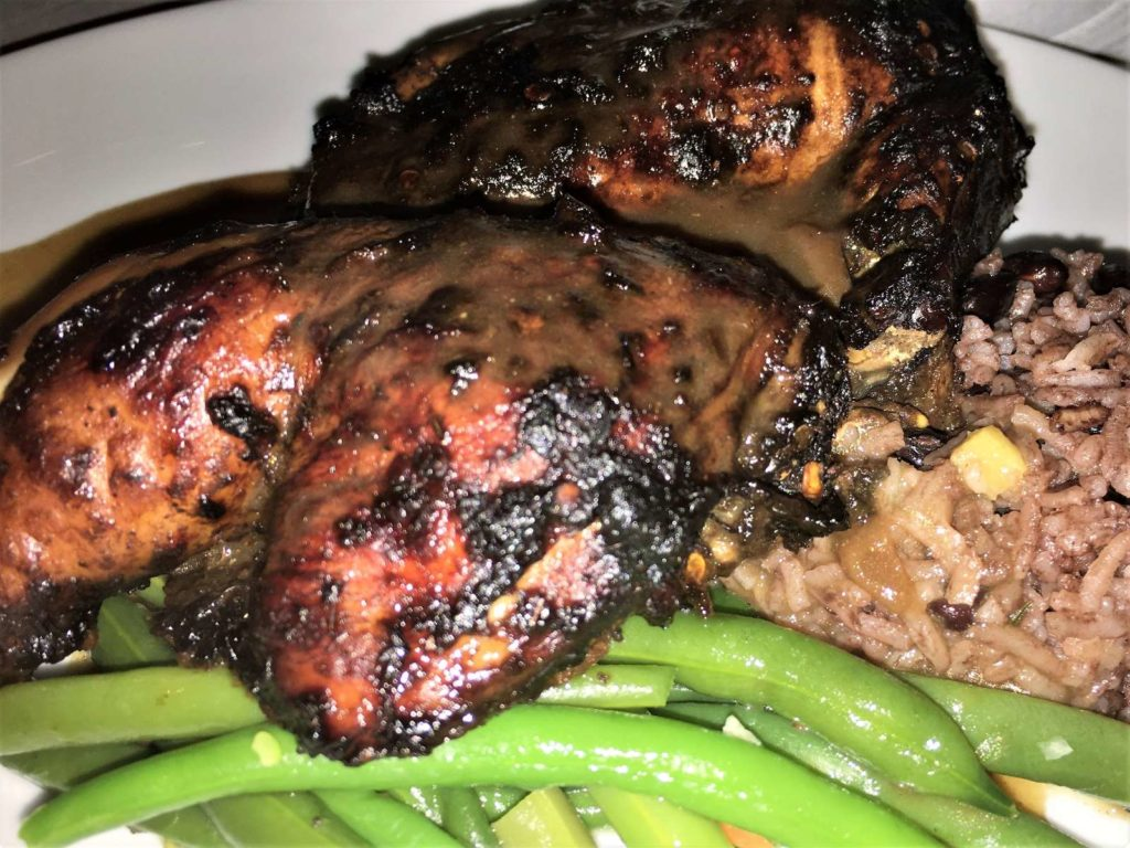 Jamaican Jerk Chicken with dirty rice and green beans in the Silhouette Dining Room