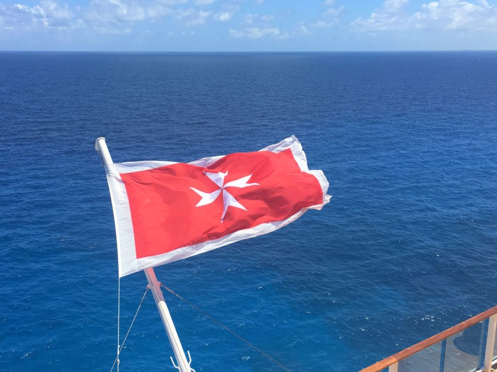 Ship's flag over the sea