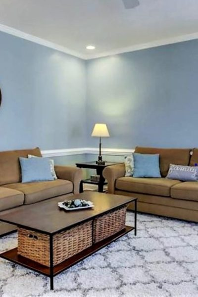 clean living room with couches, neat pillows and clear coffee table