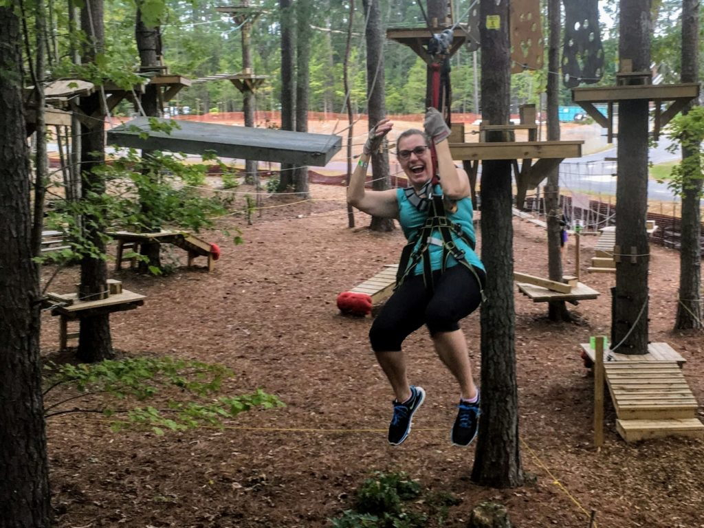 On the zip line at TreeRunner Park in Raleigh, NC